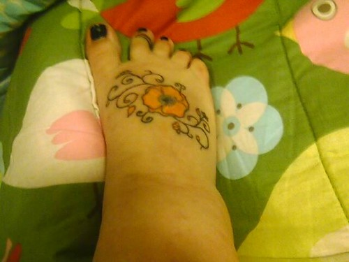 poppy tattoo. swirl tattoo