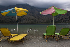 Autumn is here (Theophilos) Tags: autumn lake water clouds ducks greece crete chania  beachumbrella kournas