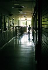 Backlit Hallway (JeffStewartPhotos) Tags: school boy summer vacation ontario canada abandoned silhouette walking holidays closed child running hallway backlit northwood darkened