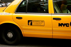 New York City cab (Fotis Korkokios) Tags: city nyc newyorkcity sky urban usa newyork yellow sepia clouds america buildings manhattan cab taxi horizon unitedstatesofamerica transport icon empirestatebuilding bigapple urbanphotography urbanenvironment nycicon canon450d fostis cityoverview canoneosdigitalrebelxsi fotiskorkokios