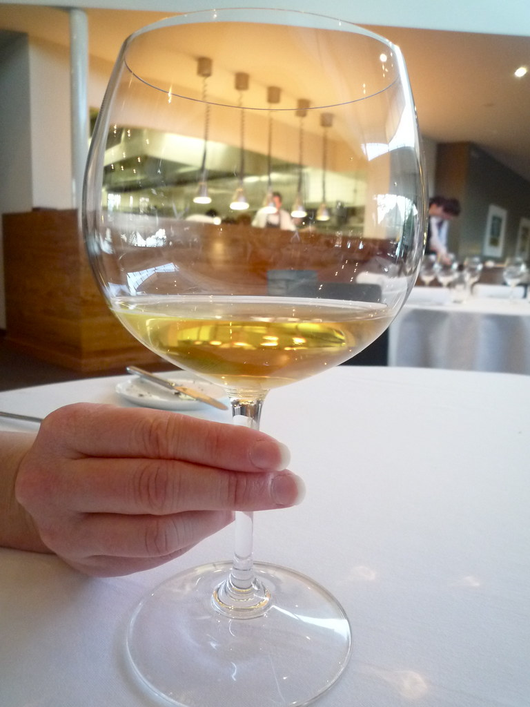 Kitchen through white wine glass