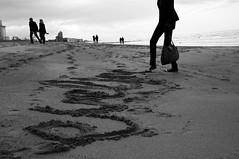 Calligraphy (bm^) Tags: sea people blackandwhite bw white black strand nikon belgium belgique zwartwit name belgi zee westvlaanderen shore calligraphy oostende zwart wit ostend  d90 blackwhitephotos westernflanders nikond90bw