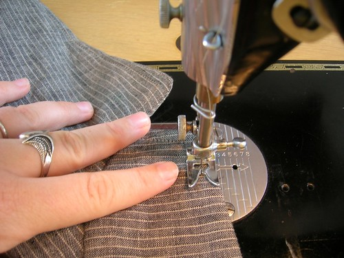 Topstitching around the perimeter of the jacket, including collar.
