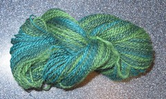 The yarn spun from a 3-color striped batt.