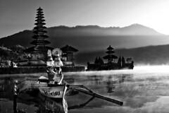 Pura Ulun Danu, Bedugul, Bali - Morning by the lake (Black and White) (Mio Cade) Tags: trip morning bali woman sun white lake black colour reflection water girl lady female sunrise canon pose indonesia landscape temple eos model colorful asia colourful pura ulun danu arrange polariser bedugul