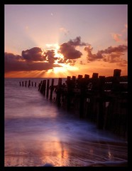 Sunrise on the Norfolk coast (ryme-intrinseca) Tags: sunset sea seascape reflection beach water sunrise coast suffolk sand long exposure great norfolk yarmouth groyne defences lowestoft hopton corton