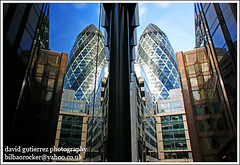 London City : Gherkin Double Take (david gutierrez [ www.davidgutierrez.co.uk ]) Tags: reflection guerkin skyscraper 30stmaryaxe foster blue thegherkin gherkin double take image photo fantastic wonderful sony dt 1118mm f4556 sonyalphadt1118mmf4556 sony350dslra350 cities cityscapes architectural photography metropolis centre center municipality structure edifice geotagged architektur building buildings spectacular impressive sensational londres londra 350 cites alpha architecture london cityscape urban arquitectura capital city swissrebuilding