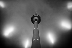 Fernsehturm Berlin, Festival of Lights 2009 (Ole Begemann) Tags: light bw berlin architecture night clouds germany deutschland licht blackwhite europa europe nacht cityscapes wolken symmetry lookingup alexanderplatz architektur fernsehturm sw mitte 2009 festivaloflights tvtower flak lightrays searchlights stadtbild symmetrie lichtstrahlen schwarzweis lowangleview berlinflickrtreffen camera:iso=400 suchscheinwerfer camera:model=canoneos20d lens:aperture=f40 camera:shutter=sec lens:focallength=20mm original:filename=2009101620d040181