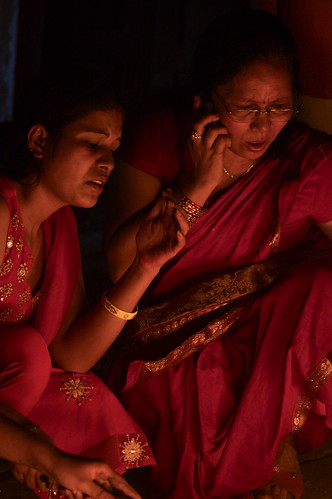 Ladies Burning Offering At A Hindu Temple, Kathmandu