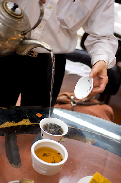 Pouring tea at Lin Heung Tea House, a dim sum restaurant in Hong Kong