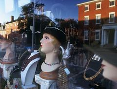 window face (Nesster) Tags: reflection window hat shop vintage nikon fuji head nh portsmouth 100 24mm fe f28 sensia 2428 nikkorn