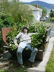 Scott Relaxing on His Vanquished Adversary  in the Skip Bin