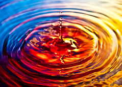 Water Drop ~ Explored ~ (Sergiu Bacioiu) Tags: blue light red orange abstract motion color macro wet water yellow closeup circle energy drink ripple wave surface drop falling clear drip droplet flowing rippled transparent splash liquid thirst isolated purity splashing platinumphoto