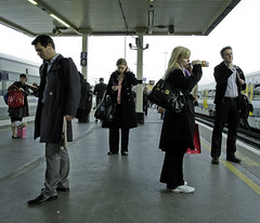 Just Another Commute (Sven Loach) Tags: uk england london water mobile train canon londonbridge evening early bottle waiting afternoon ipod britain candid platform drinking streetphotography cell passengers explore commute headphones bags newpaper southlondon overground phones commuters texting tfl g12 southeastern londonist myfoto svenloachportfolio