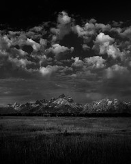 above these walls ([Adam Baker]) Tags: park morning summer bw white black mountains clouds canon grand august monotone junction national prairie teton moran wy 1740l gtnp adambaker 5dmarkii buffalowereroamingjustoffcamerabuttheydidntwanttoposeforme