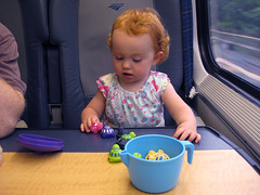 playing with plastic turtles on the Acela train