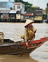 On the Mekong Delta (Matteo Allegro [www.matteoallegro.com]) Tags: woman water hat river asia fat young delta east vietnam southeast mekong abigfave concordians