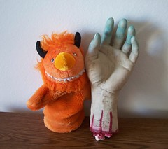Helix and a creepy hand (helixdmonster) Tags: orange monster puppets helix handpuppets severedhand creepyhands monsterhandpuppets helixdmonster