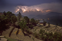 A Bright and Stormy Night (acastellano) Tags: trees nepal sky storm topf25 weather night clouds trekking terrace hiking farm hills moonlight thunderstorm lightning climate lpsky