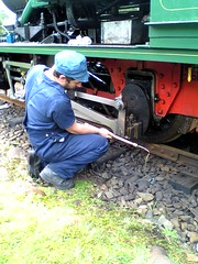 Driver checking the oil in the ABT Locomotive