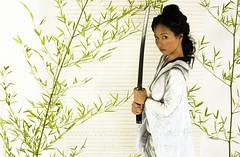 Kamodo IVIV (Wizard of Wonders) Tags: woman canada lady asian bc surrey bodypaint whitebackground sword blackhair kamododress