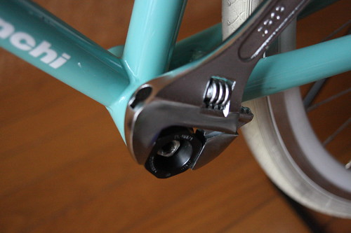 Tighten bottom bracket (left side)