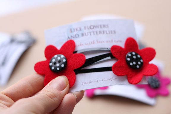 hair clips red with black buttons