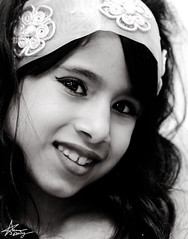 "a recovery smile (""Anwaar) Tags: portrait white black cute girl beautiful canon hair kid eyes photographer sweet sister 100mm daisy arabian say f28 plz kuwaiti dema mashalah 400d anwaar"