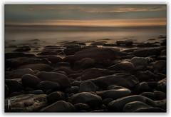 Misty Rocks - Dunraven Bay (Sylvia Slavin ARPS (woodelf)) Tags: light sunset sea wales reflections bay seaside nikon long exposure stones 10 stopper dunraven d700