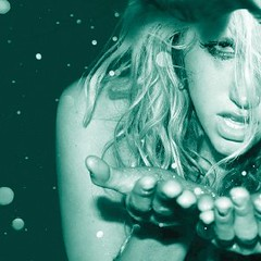 an artistic, green photo of the pop star Ke$ha looking high or wasted