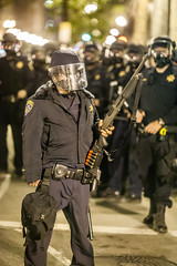Oakland 2010 (Thomas Hawk) Tags: california usa oakland riot gun cops unitedstates unitedstatesofamerica protest police cop chp gasmask eastbay riots fav10 californiahighwaypatrol fav25 oscargrant oaklandriots johannesmersehle oaklandca070810 oaklandriots2010