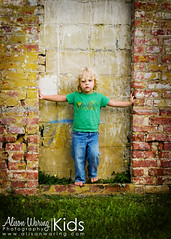 I can't think of a good title (Alison Waring) Tags: wall naturallight textures jeans brickwall barefoot mybaby curlyhair youngest superheros blondhair hes2 toddlah