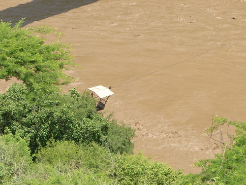 Small gondola seems to be used to cross Blue Nile.