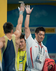 Lu high five with coach (Rob Macklem) Tags: china men record sa kg 77 lu olympicweightliftingkoreaworldchampionshipsgoyangcity