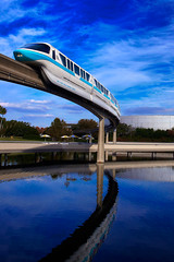 Monorail Teal (janoimagine) Tags: water clouds digital canon reflections orlando epcot florida disney disneyworld transportation bigsky monorail waltdisneyworld polarizer canoneos epcotcenter testtrack waltdisney futureworld markiv worldofmotion canon1740mml canon50d waltdisneyworldmonorailsystem epcotbeam monorailmarkiv
