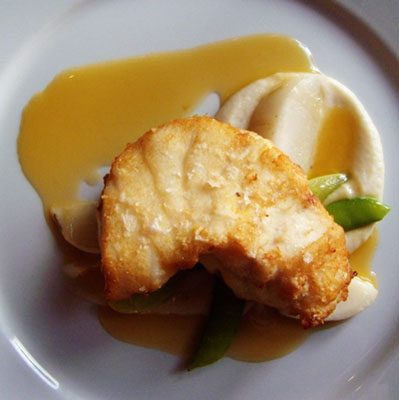 Monkfish with apples flavored butter sauce and cauliflower puree