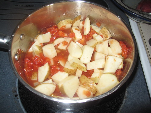 Potatoes and tomatoes starting to cook for peanut curry