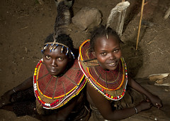 Pokot girls with feathers on the head - Kenya (Eric Lafforgue) Tags: africa portrait people face beads kenya culture tribal human tribes bead afrika tradition tribe ethnic kenia tribo gens visage afrique ethnology tribu eastafrica rift beadednecklace qunia 7632 lafforgue ethnie  qunia    beadsnecklace kea    humainpersonne a