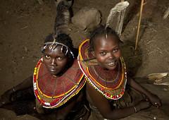 Pokot girls with feathers on the head - Kenya (Eric Lafforgue) Tags: africa portrait people face beads kenya culture tribal human tribes bead afrika tradition tribe ethnic kenia tribo gens visage afrique ethnology tribu eastafrica rift beadednecklace quénia 7632 lafforgue ethnie ケニア quênia كينيا 케냐 кения beadsnecklace keňa 肯尼亚 κένυα кенија humainpersonne кенијa
