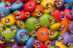 smart refraction (daitoZen) Tags: blue red orange color colour detail macro reflection green water beauty smart studio photography waterdrop colorful dof candy availablelight stock experiment vivid funky drop h2o lsd smarties refraction sweets mm rgb liquid catchy tabletop eyecatcher giap strobist getty01 giap0410 onsalegi