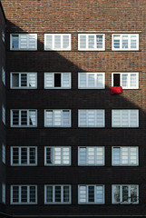 uniformity break (crosslens) Tags: windows red bricks blanket uniformity fassade