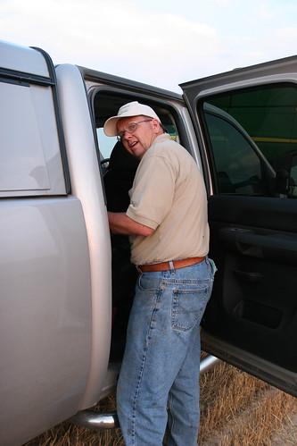 A John Deere Rep helps fix our combine.