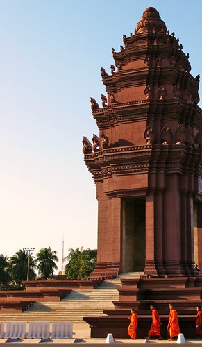 Monks circumabulate Independence Monument at sunset - Phnom Penh, Cambodia