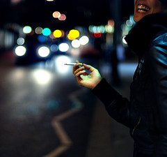 Laughing at my Cries (NyYankee) Tags: road street uk london night 50mm lights chelsea bokeh f14 cigarette smoke explore kings nikkor manuela frontpage sloaney