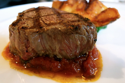 Grilled beef tenderloin and Crunchy potatoes, Tomato Compote with Chilies and Garlic