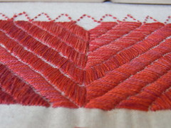 Ginevra's project: detail of reds (GinevraMakes) Tags: red embroidery badge messy 1sttime redwork careless tribalstyle ethnicstyle thequiltproject