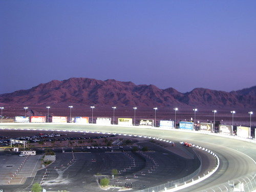 Turn Two at LVMS in the Evening with mountains as a backdrop.