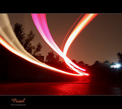 Don't  worry, the camera safely! (Faisal | Photography) Tags: nightphotography red black car night speed shot explore l usm frontpage f28 ef ef2470mmf28lusm 2470mm canoneos50d riyadhsaudiarabia canonremoteswitchrs80n3 faisal|photography »longexposure فيصلالعلي