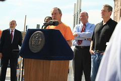 Mayor Bloomber speaks at the NYC °CoolRoofs press conference.  Richard Cherry, CEC president, stands at left. Former Vice President Al Gore is to the right.