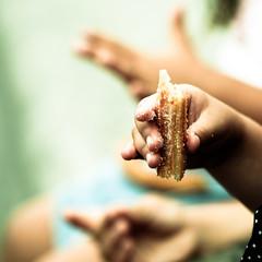 """time for a """"churro"""" - momento churro (albantzar [ itziar ]) Tags: hot canon chocolate dough frida 100mm sugar fried eta caliente beste churro azcar merienda dirtyhands guztiak manossucias 1000d atzekaldean"""